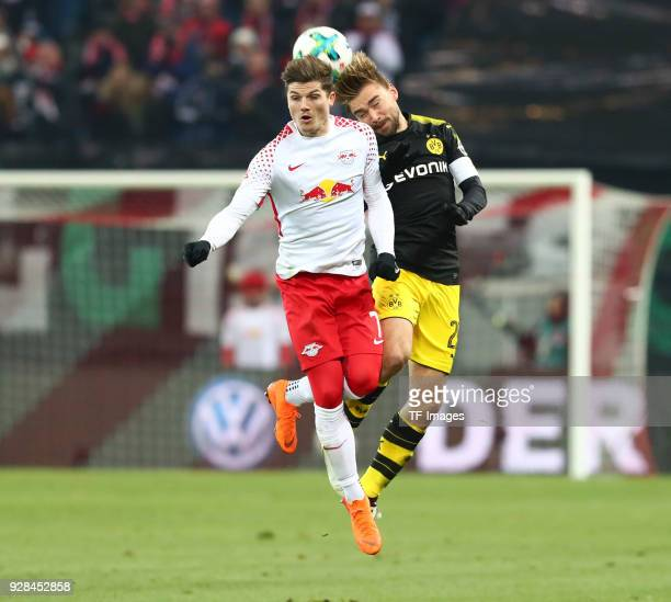 Marcel Sabitzer of Leipzig and Marcel Schmelzer of Dortmund battle for the ball during the Bundesliga match between RB Leipzig and Borussia Dortmund...