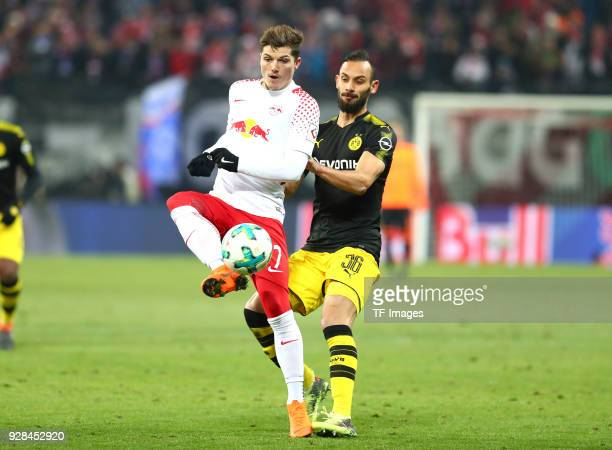 Marcel Sabitzer of Leipzig and Oemer Toprak of Dortmund battle for the ball during the Bundesliga match between RB Leipzig and Borussia Dortmund at...