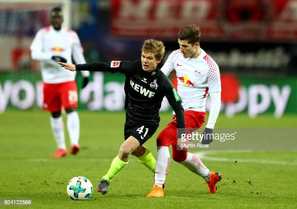 Marcel Sabitzer of Leipzig and Vincent Koziello of Koeln battle for the ball during the Bundesliga match between RB Leipzig and 1 FC Koeln at Red...