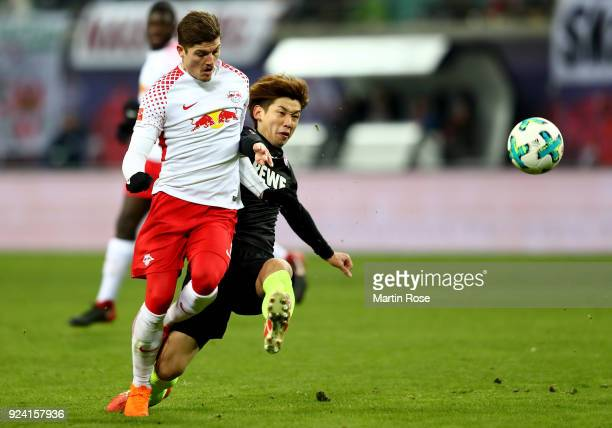 Marcel Sabitzer of Leipzig and Yuya Osako of Koeln battle for the ball during the Bundesliga match between RB Leipzig and 1 FC Koeln at Red Bull...