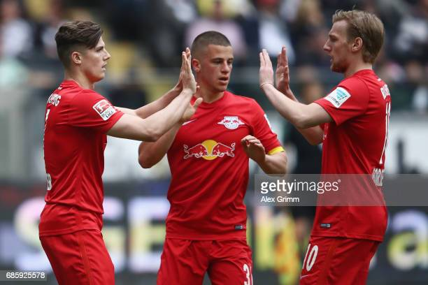 Marcel Sabitzer of Leipzig celebrates his team's first goal with team mates Diego Demme and Emil Forsberg during the Bundesliga match between...