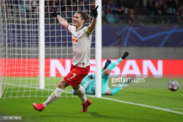Marcel Sabitzer of Leipzig celebrates his team's second goal during the UEFA Champions League round of 16 second leg match between RB Leipzig and...