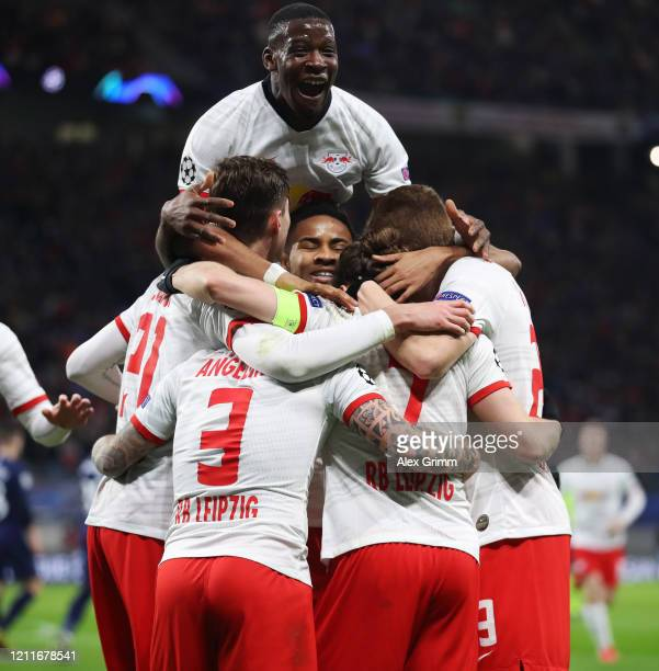 Marcel Sabitzer of Leipzig celebrates his team's second goal with team mates during the UEFA Champions League round of 16 second leg match between RB...