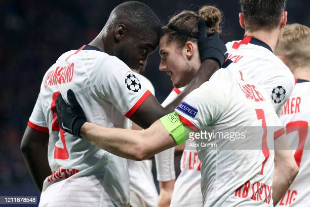 Marcel Sabitzer of Leipzig celebrates his team's second goal with team mate Dayot Upamecano during the UEFA Champions League round of 16 second leg...