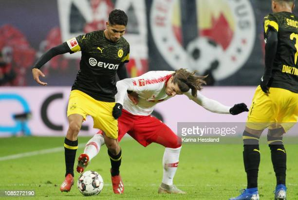 Marcel Sabitzer of Leipzig challenges Achraf Hakimi of Dortmund during the first Bundesliga match between RB Leipzig and Borussia Dortmund at Red...