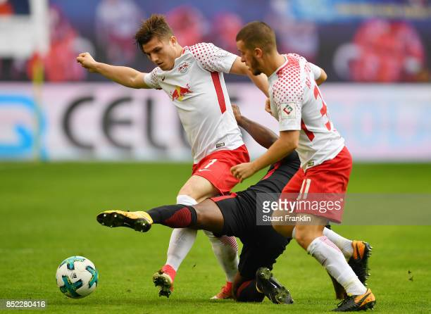 Marcel Sabitzer of Leipzig fights for the ball with Jetro Willems of Frankfurt / and Diego Demme of Leipzig during the Bundesliga match between RB...