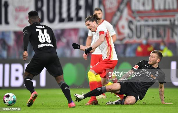 Marcel Sabitzer of Leipzig is challenged by Louis Beyer of Gladbaduring the Bundesliga match between RB Leipzig and Borussia Moenchengladbach at Red...