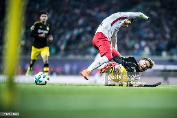 Marcel Sabitzer of Leipzig is tackled by Marcel Schmelzer of Dortmund during the Bundesliga match between RB Leipzig and Borussia Dortmund at Red...