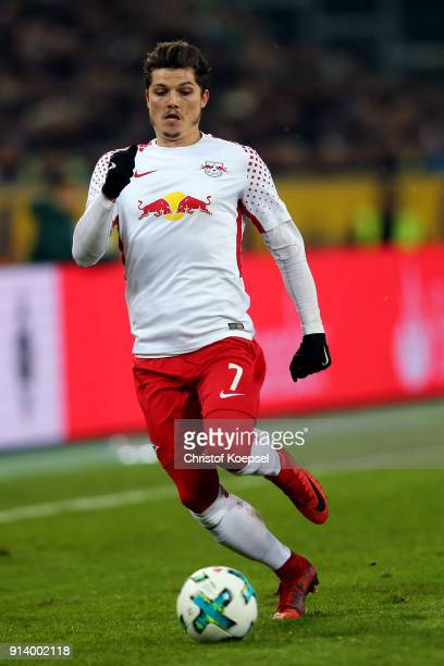 Marcel Sabitzer of Leipzig runs with the ball during the Bundesliga match between Borussia Moenchengladbach and RB Leipzig at BorussiaPark on...