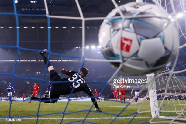 Marcel Sabitzer of Leipzig scores his team's first goal past goalkeeper Alexander Nuebel of Schalke during the Bundesliga match between FC Schalke 04...