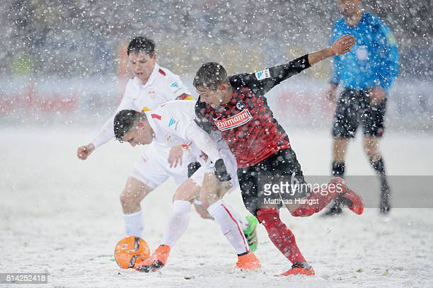 Marcel Sabitzer of RB Leipzig and Amir Abrashi of Freiburg compete for the ball during the Second Bundesliga match between SC Freiburg and RB Leipzig...