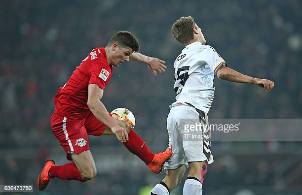 Marcel Sabitzer of RB Leipzig and Daniel Buballa of St Pauli battle for the ball during the Second Bundesliga match between FC St Pauli and...