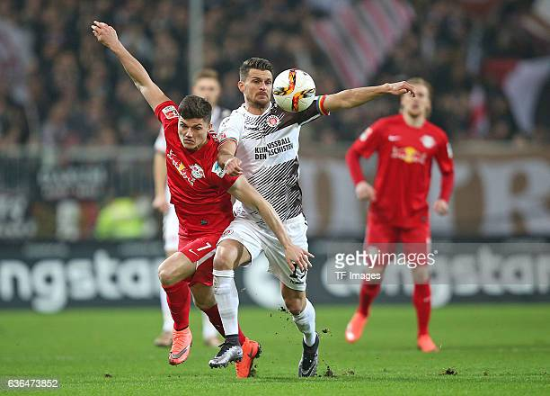 Marcel Sabitzer of RB Leipzig and Enis Alushi of St Pauli battle for the ball during the Second Bundesliga match between FC St Pauli and...