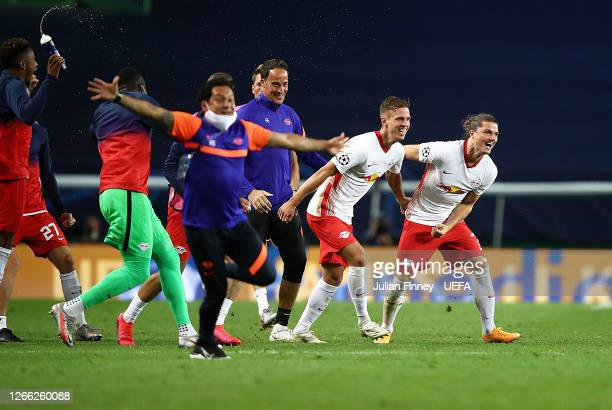 Marcel Sabitzer of RB Leipzig and his teammates and their staff celebrate following their team's victory in the UEFA Champions League Quarter Final...