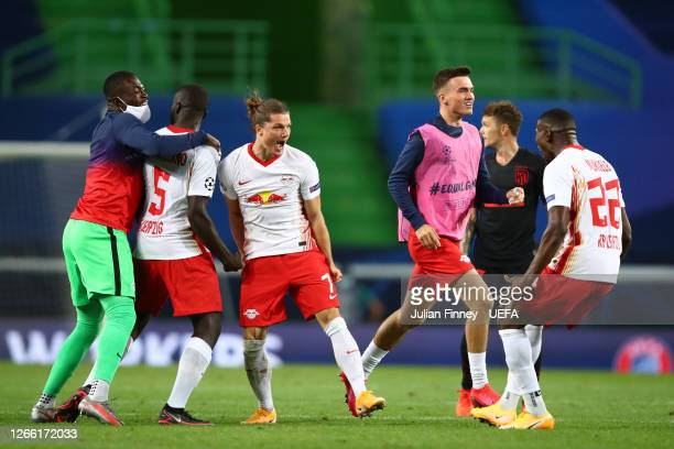 Marcel Sabitzer of RB Leipzig and Nordi Mukiele of RB Leipzig celebrate following their team's victory in the UEFA Champions League Quarter Final...