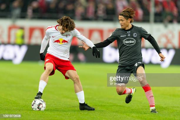 Marcel Sabitzer of RB Leipzig and Takashi Usami of Fortuna Duesseldorf battle for the ball during the Bundesliga match between Fortuna Duesseldorf...