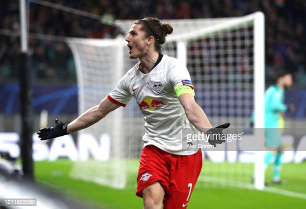 Marcel Sabitzer of RB Leipzig celebrates after scoring his sides second goal during the UEFA Champions League round of 16 second leg match between RB...