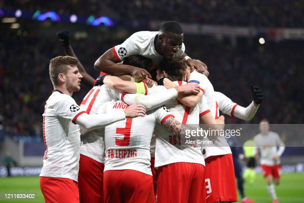 Marcel Sabitzer of RB Leipzig celebrates with his team after scoring his sides second goal during the UEFA Champions League round of 16 second leg...