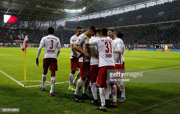 Marcel Sabitzer of RB Leipzig celebrates with team mates after scoring his team's second goal during the Bundesliga match between RB Leipzig and TSG...