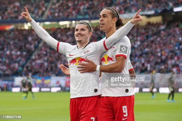 Marcel Sabitzer of RB Leipzig celebrates with teammate Yussuf Poulsen after scoring his team's first goal during the Bundesliga match between RB...