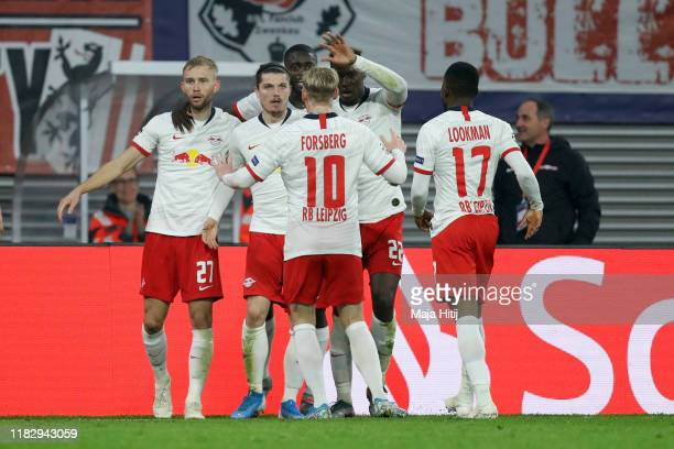 Marcel Sabitzer of RB Leipzig celebrates with teammates after scoring his team's second goal during the UEFA Champions League group G match between...
