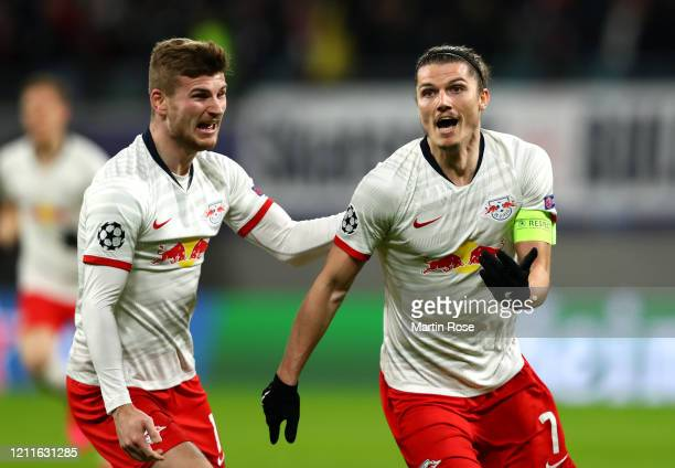 Marcel Sabitzer of RB Leipzig celebrates with Timo Werner of RB Leipzig after scoring his sides first goal during the UEFA Champions League round of...