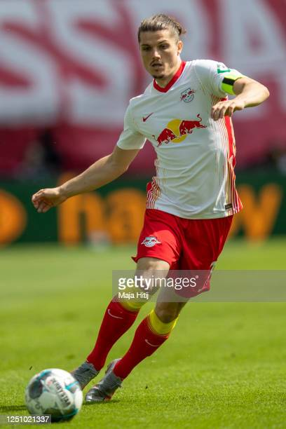 Marcel Sabitzer of RB Leipzig controls the ball during the Bundesliga match between RB Leipzig and Borussia Dortmund at Red Bull Arena on June 20,...