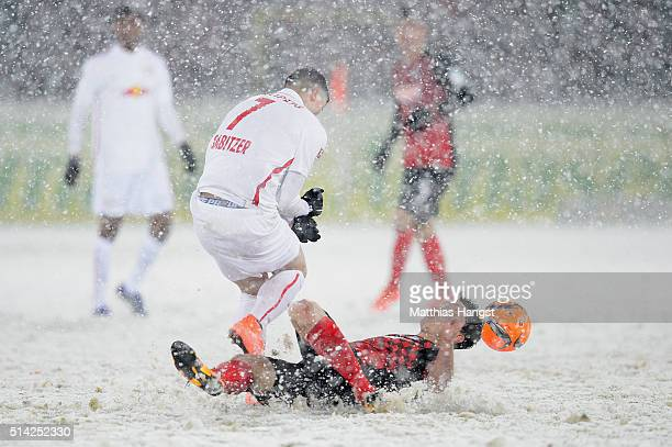 Marcel Sabitzer of RB Leipzig is challenged by Nicolas Hoefler of Freiburg during the Second Bundesliga match between SC Freiburg and RB Leipzig at...