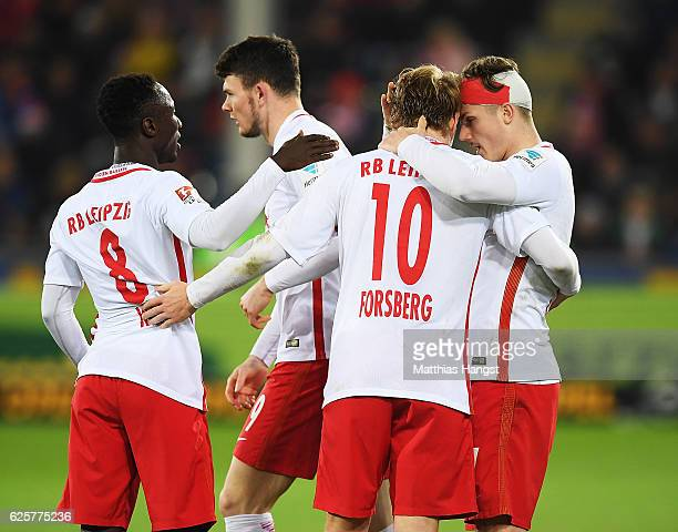 Marcel Sabitzer of RB Leipzig is congratulated by Emil Forsberg of RB Leipzig after scoring the fourth goal during the Bundesliga match between SC...
