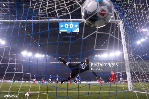 Marcel Sabitzer of RB Leipzig scores his team's first goal as Alexander Nuebel of FC Schalke 04 makes a mistake during the Bundesliga match between...