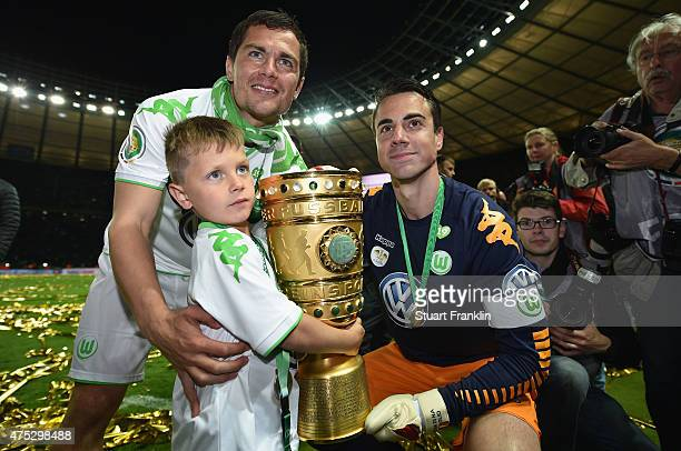 Marcel Schaefer of VfL Wolfsburg and Diego Benaglio of VfL Wolfsburg celebrate following the DFB Cup Final match between Borussia Dortmund and VfL...
