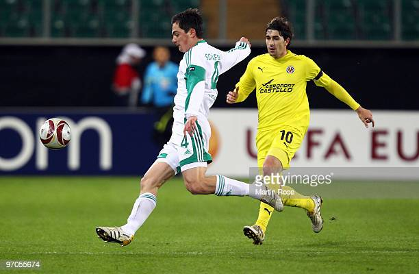 Marcel Schaefer of Wolfsburg and Cani of Villareal compete for the ball during the UEFA Europa League knock-out round, second leg match between VfL...