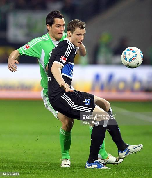 Marcel Schaefer of Wolfsburg and Marcell Jansen of Hamburg battle for the ball during the Bundesliga match between VfL Wolfsburg and Hamburger SV at...