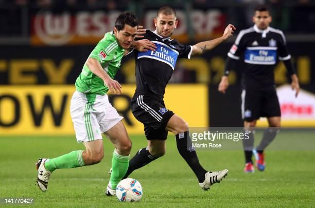 Marcel Schaefer of Wolfsburg and Mladen Petric of Hamburg battle for the ball during the Bundesliga match between VfL Wolfsburg and Hamburger SV at...