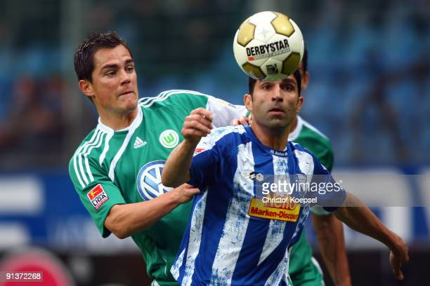 Marcel Schaefer of Wolfsburg and Vahid Hashemian of Bochum jump for a header during the Bundesliga match between VFL Bochum and VfL Wolfsburg at...