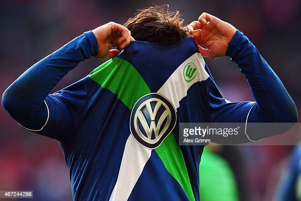 Marcel Schaefer of Wolfsburg pulls of Offenbach his jersey after the Bundesliga match between 1 FSV Mainz 05 and VfL Wolfsburg at Coface Arena on...