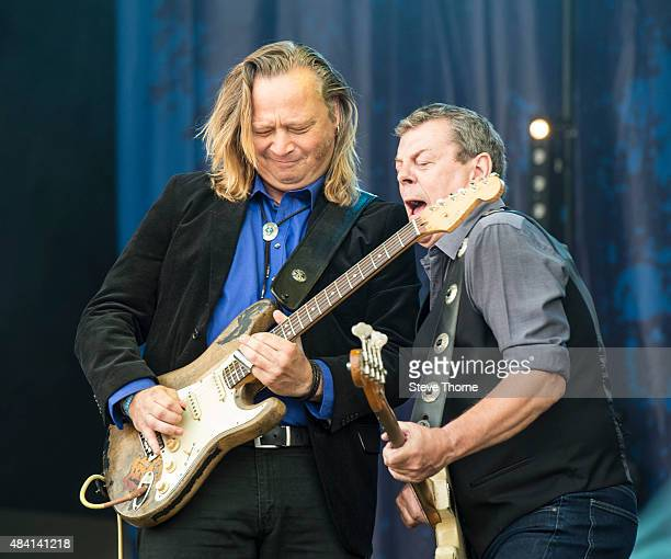 Marcel Scherpenzeel and Gerry McAvoy of Band Of Friends perform onstage at Fairport's Cropredy Convention on August 15 2015 in Banbury England