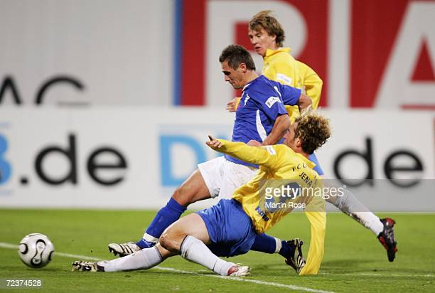 Marcel Schied of Rostock and Holger Hasse of Jena fight for the ball during the Second Bundesliga match between Hansa Rostock and Carl Zeiss Jena at...