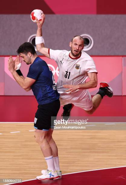 Marcel Schiller of Team Germany shoots at goal over Gaston Alberto Mourino of Team Argentina during the Men's Preliminary Round Group A match between...