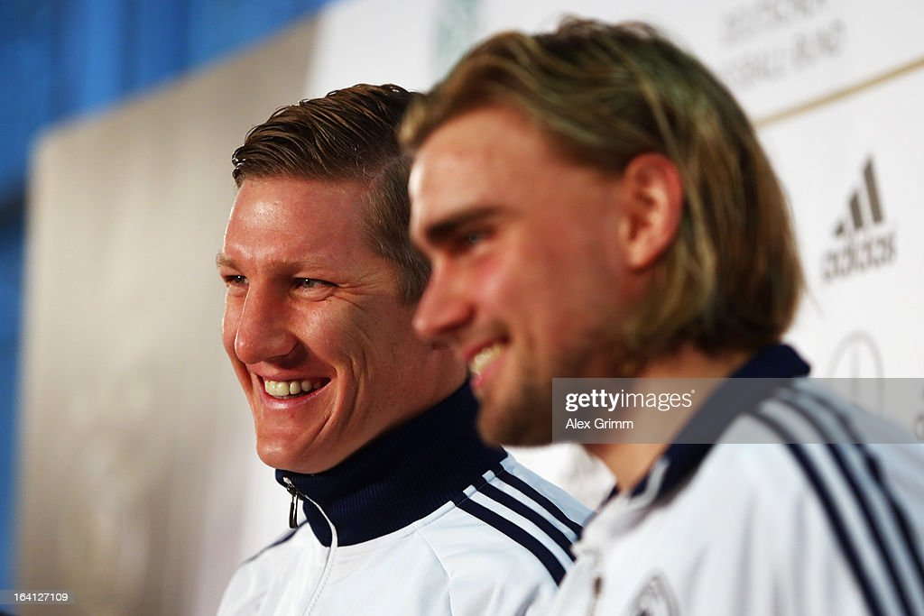 Marcel Schmelzer (front) and Bastian Schweinsteiger smile during a Germany press conference at the DFB headquarters on March 20, 2013 in Frankfurt am Main, Germany.