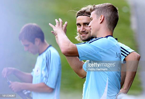 Marcel Schmelzer and Lars Bender of Germany chat during a training session on September 04, 2012 in Barsinghausen, Germany, three days before their...