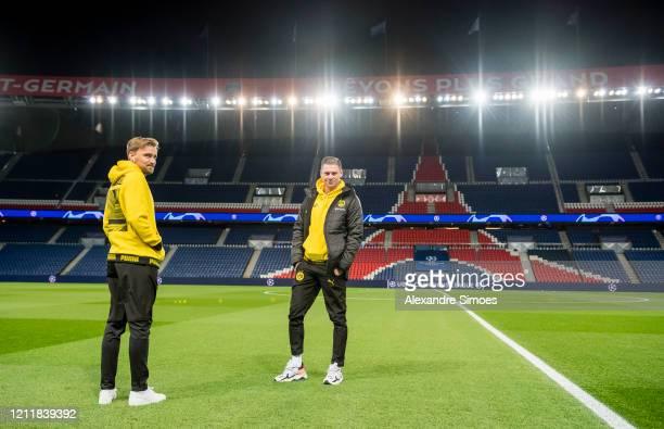 Marcel Schmelzer and Lukasz Piszczek of Borussia Dortmund arrive for the UEFA Champions League round of 16 second leg match between Paris...