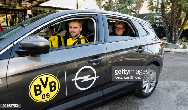 Marcel Schmelzer and stadium announcer Norbert Dickel of Borussia Dortmund during a game called 'Quiz Taxi' for the sponsor Opel as part of the third...