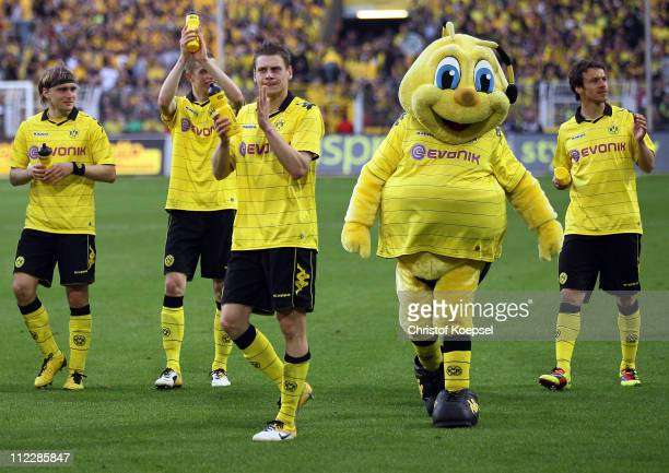 Marcel Schmelzer Lukasz Piszczek mascot Emma and Markus Feulner of Dortmund celebrates the 30 victory after the Bundesliga match between Borussia...