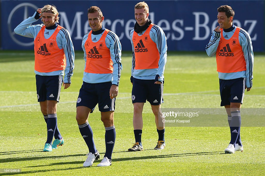 Marcel Schmelzer, Miroslav Klose, Marco Reus and Mesut Oezil smile during the training session of Germany at Amateur Stadium on October 14, 2012 in Berlin, Germany.