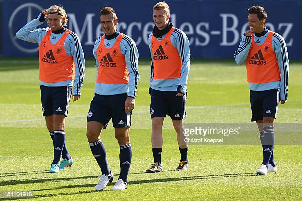 Marcel Schmelzer Miroslav Klose Marco Reus and Mesut Oezil smile during the training session of Germany at Amateur Stadium on October 14 2012 in...
