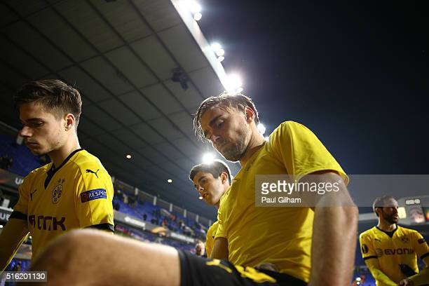 Marcel Schmelzer of Borussia Dortmund celebrates victory with their fans after the UEFA Europa League round of 16 second leg match between Tottenham...