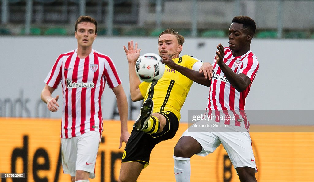 Marcel Schmelzer of Borussia Dortmund challenges Inaki Williams of Athletic Bilbao during the friendly match between Athletic Bilbao and Borussia Dortmund at AFG Arena on August 09, 2016 in St. Gallen, Switzerland.
