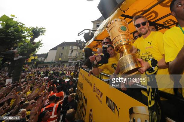 Marcel Schmelzer of Borussia Dortmund greets fans as the team celebrates during a winner's parade at Borsigplatz on May 28 2017 in Dortmund Germany