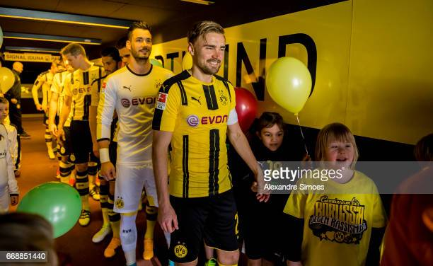 Marcel Schmelzer of Borussia Dortmund on his way to the field prior to the Bundesliga match between Borussia Dortmund and Eintracht Frankfurt at...